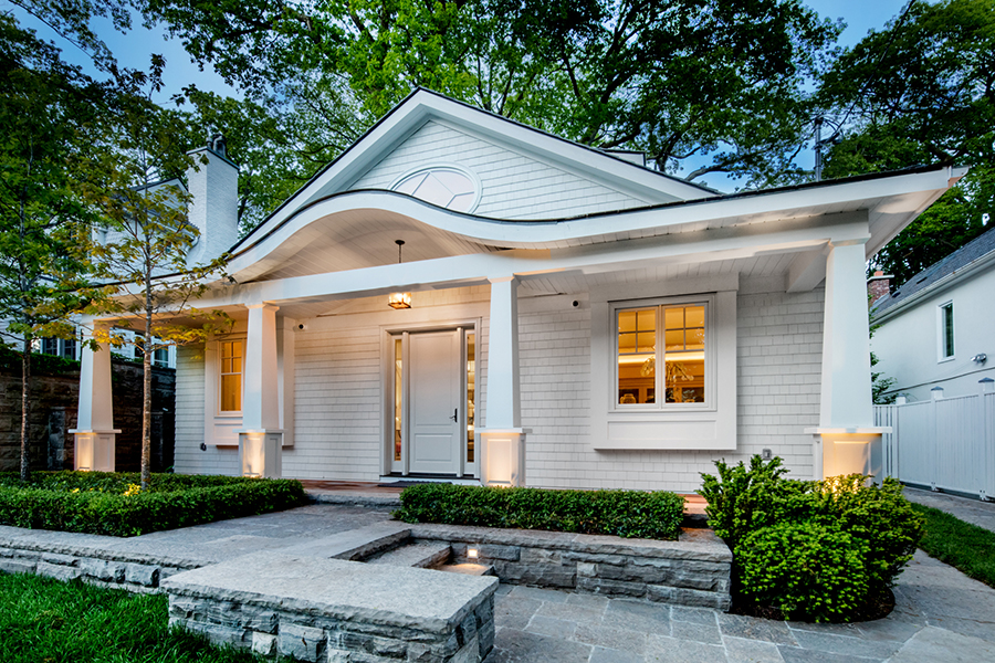 The Curved Front Porch Evokes Waves Of Lake Ontario